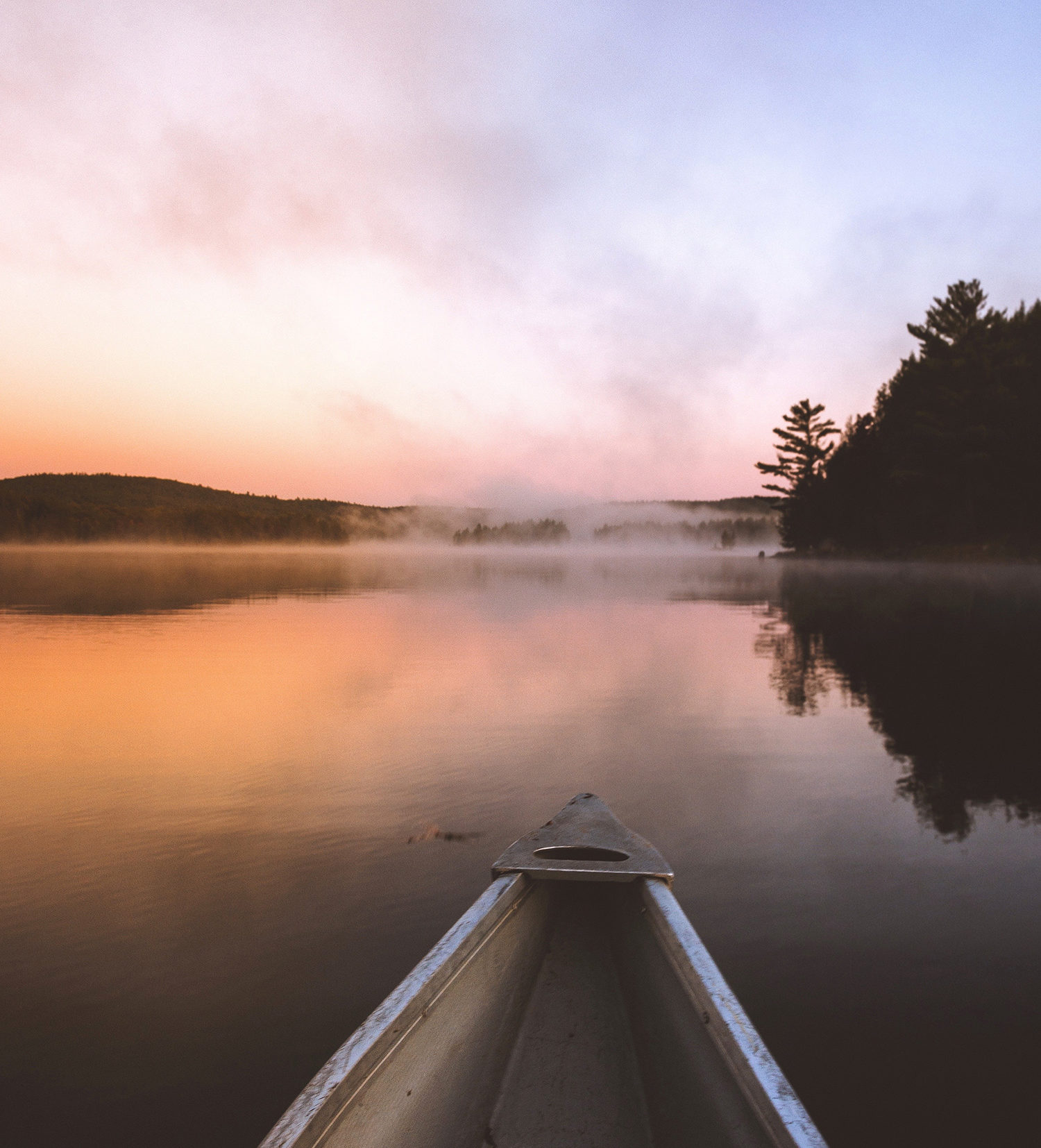 Sunrise in a canoe looking for bass.