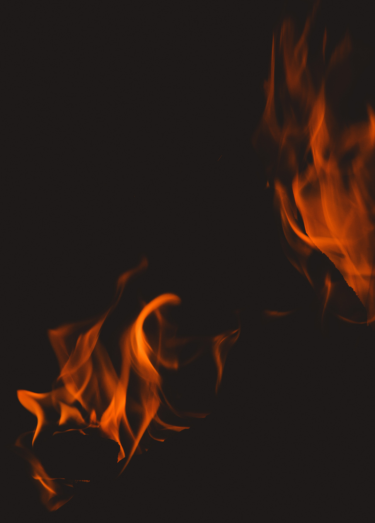 Campfire burns an orange glow