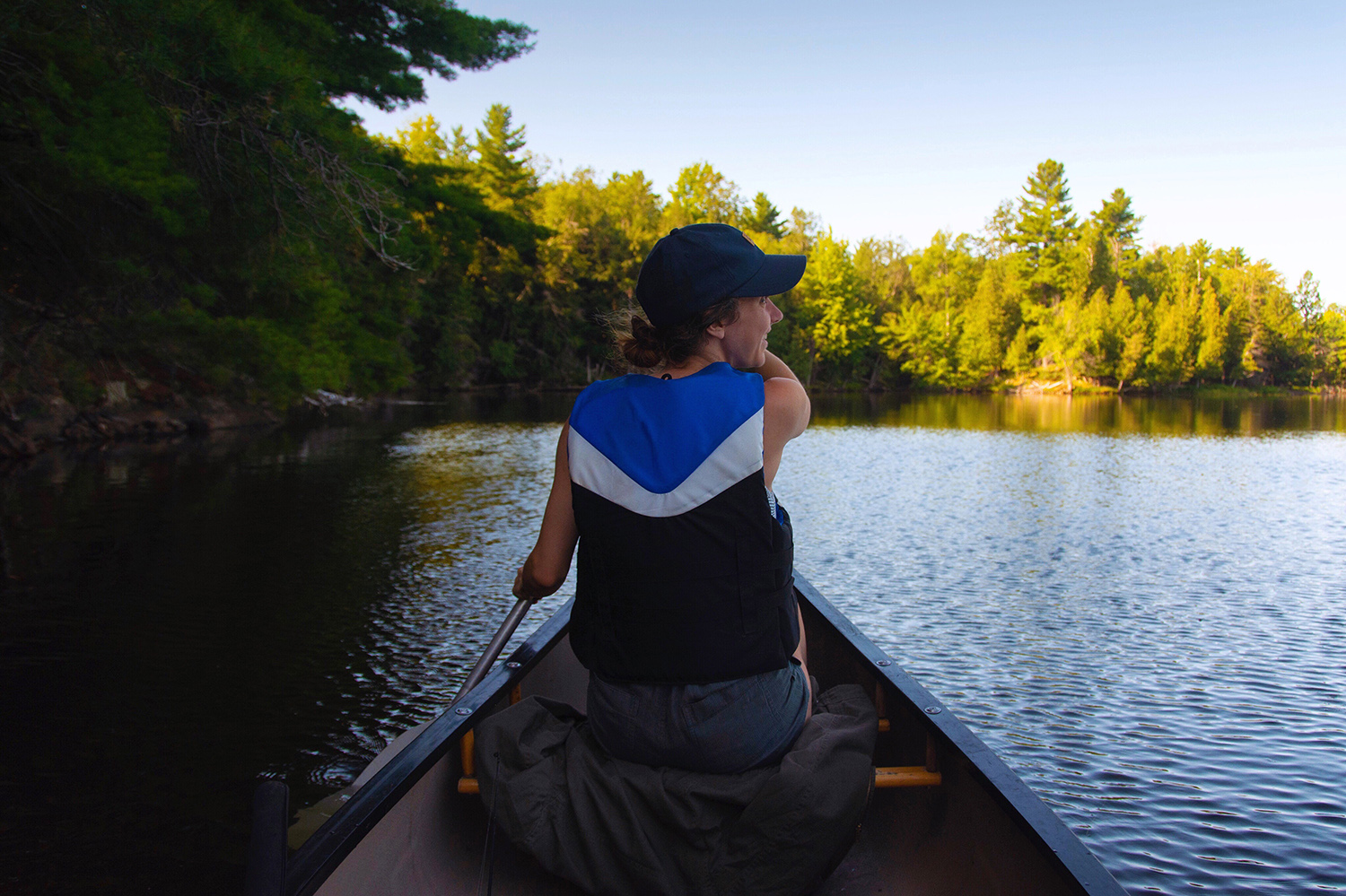 A woman canoes at Murphy's Point Provincial Park
